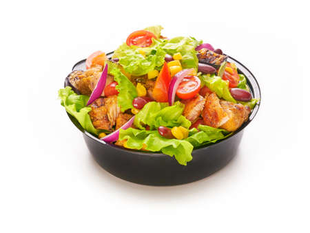 Fresh healthy salad with chicken, cherry tomatoes, red onion, lettuce, sweet corn and beans, fast food delivery concept take away plastic bowl or container on white background Stockfoto - 153024828