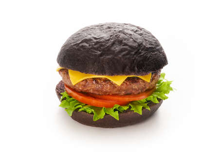 Black burger with beef meat cheese lettuce onion, tomato isolated on a white background, fast food and take away delivery concept