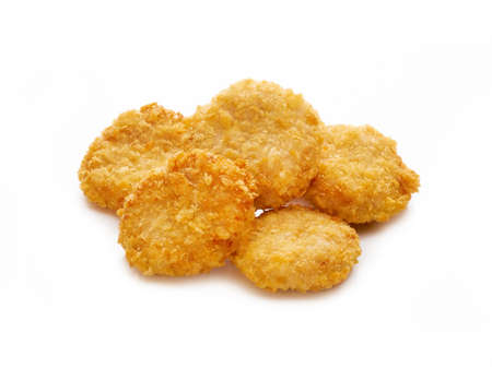 Fried crispy chicken nuggets on white background
