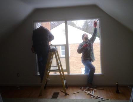 Two men install windows