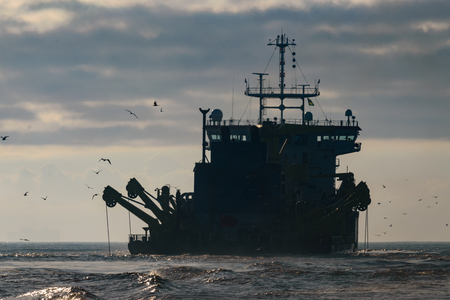 Maritime Industry: Dredger In Action