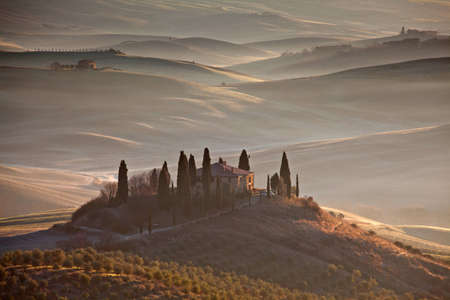 sienna: Tuscan farmhouse in morning mist