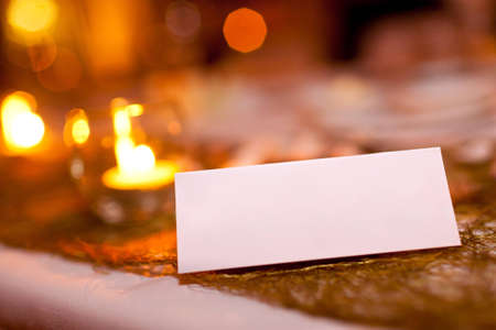 Blank place card at a wedding suitable for adding names or\ text to