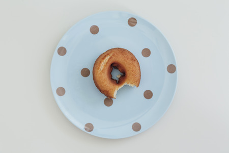 bitten: Donut bitten Stock Photo