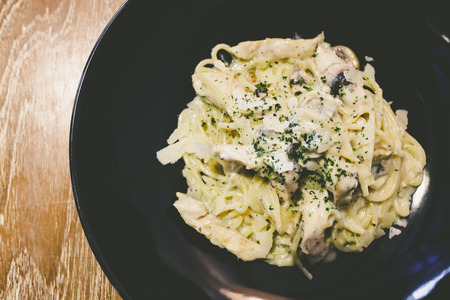 alfredo pasta with chicken and mushrooms Stock Photo