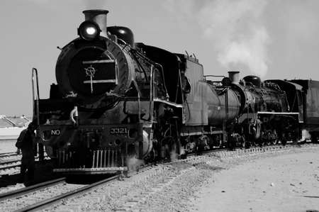black history: Black and white of vintage steam train preparing to depart from Swakopmund station on Namibias westcoast