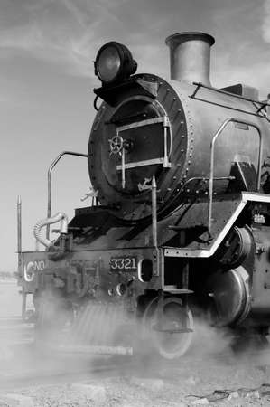 Black and white of vintage steam train preparing to depart from Swakopmund station on Namibias westcoast photo