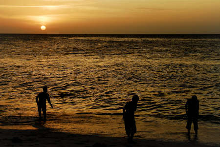 Children playing on a beach at sunset Stock Photo - 10191481
