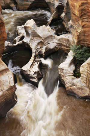 River rushing through Bourkes Luck Potholes in Blyde River Canyon, South Africa photo