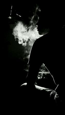man: man smoking in the dark