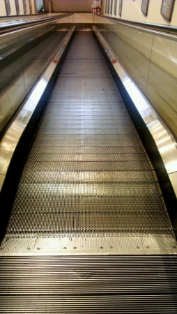 moving down: Escalator in shopping mall  Stock Photo