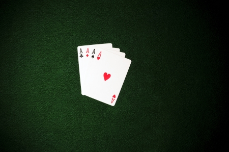 4 aces on green background photo