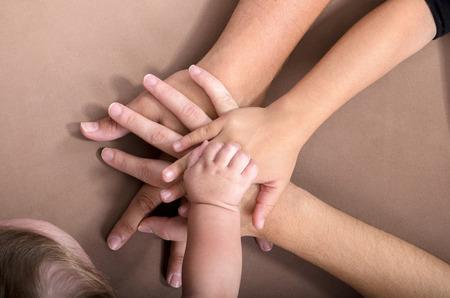 baby in hands: family hands sack Stock Photo
