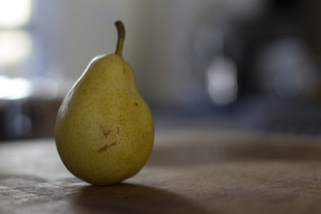 rule of thirds: Pear on bench top small depth of field