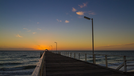 rule of thirds: Jetty sunset Henley beach leading lines Stock Photo