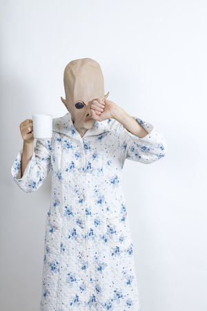 parody: Alien difficult to wake in the morning Rubbing ones eyes and drinking a big cup of coffee dressing-up clothes and conceptual parody