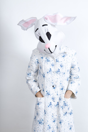parody: rabbit difficult to wake in the morning dressing-up clothes and conceptual parody Stock Photo