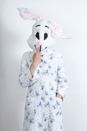 parody: rabbit difficult to wake in the morning he is touching his nose dressing-up clothes and conceptual parody