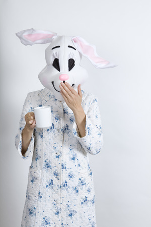 Rabbit difficult to wake in the morning He put his hand in front of his mouth after he have have spoken too hastily  dressing-up clothes and conceptual parody