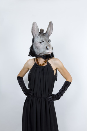 pretentious: Woman wearing a donkey mask with an evening dress and evening gloves