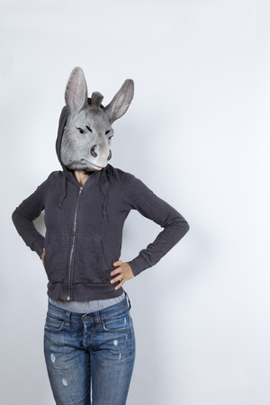 Woman wearing a donkey mask and miming hip hop culture She is wearing a hoody and a jeans with holes