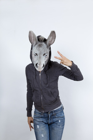 hoody: Woman wearing a donkey mask and miming hip hop culture She is wearing a hoody and a jeans with holes