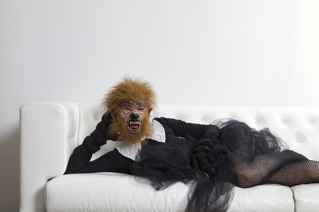 animal tutu: werewolf woman wearing a tutu and sitting on a white sofa Stock Photo