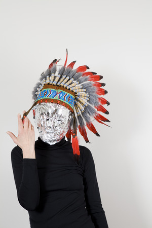 Head coated with aluminum foil and headdress american indian native Stock Photo