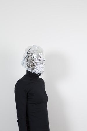 Head coated with aluminum foil Stock Photo