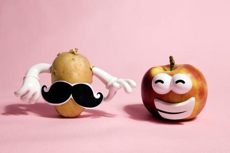 a pop and minimal potato portrait on a pink background Stock Photo
