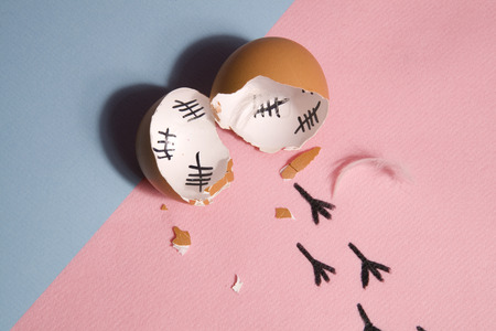 jailbreak: The counting of the days on a broken egg with footprint on a pink and blue background