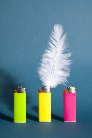 A feather in place of a flame on a lighter