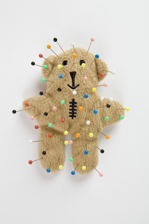 vodoo: a quirky teddy bear like a voodoo doll isolated