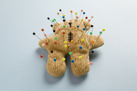 a quirky teddy bear like a voodoo doll isolated