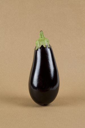 Minimal still life photography. Eggplant isolated on a kraft paper