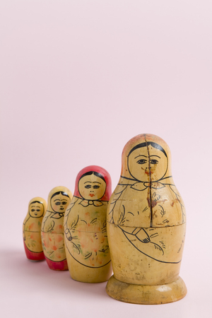 an old matrioshka on a vibrant pink background. Minimal color still life photography Stock Photo