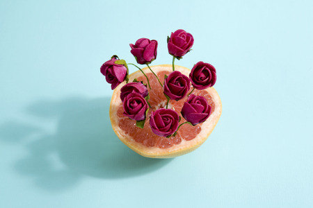 poetic: Minimalist and poetic composition of red roses growing in a grapefruit Minimal color still life photography
