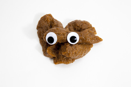 a pile of Poo with doll eyes