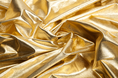 close-up view of a gold piece of fabric like ripples. Luxury composition. Minimal color still life photography. Minimal color still life photography Stok Fotoğraf