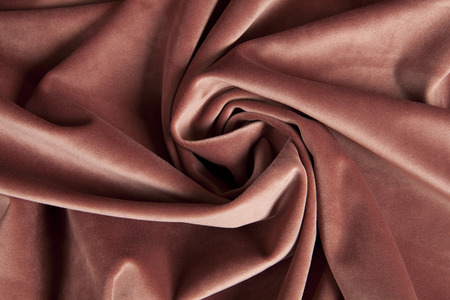 close-up view of an old pink velvet curtain. Minimal color still life photography Stock Photo