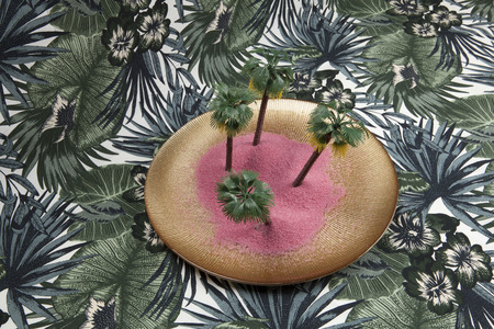 pink sand and palm trees in a golden plate on a tropical background. Minimal still life color photography., Stock Photo