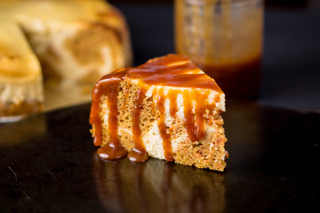 drizzle: Slice of Carrot Cheesecake With Caramel Topping. This marble cake is a mix of carrot cake and cheesecake swirled together and topped with caramel sauce.