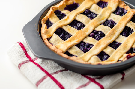 Homemade blueberry pie cooling off in a baking pan. Foto de archivo