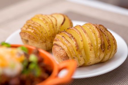 side dish: Side dish of oven baked & roasted hasselback potatoes.