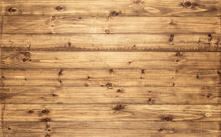 Light brown wood texture background viewed from above. The wooden planks are stacked horizontally and have a worn look. This surface would be great as design element for a wall, floor, table etc…