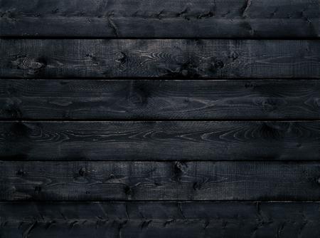 Nero scuro legno texture di sfondo vista dall'alto. Le tavole di legno sono accatastati in orizzontale e hanno un aspetto vissuto. Questa superficie sarebbe grande come elemento di design per un muro, da terra, tavolo, ecc Archivio Fotografico - 53301988