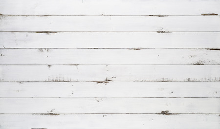 Distressed white wood texture background viewed from above. The wooden planks are stacked horizontally and have a worn look. Imagens