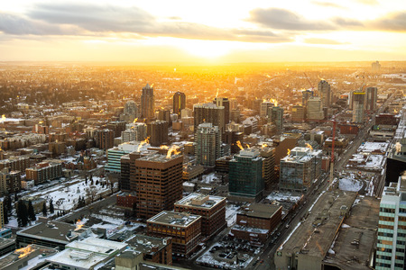 glooming: Sunset over the city of Calgary in winter. Taken from the Calgary Tower, overlooking the south-west downtown side of the urban city.