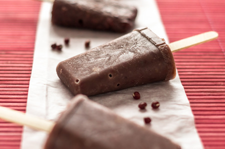 value add: The perfect sweet treat to cool off during hot summer days, this homemade popsicle is made with asian adzuki red beans ice cream. The frosted beans add texture to the ice pops and also boost the nutritional value, making it an healthier dessert choice for