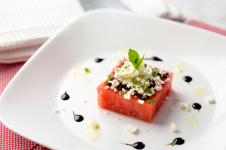 Watermelon and feta salad. This watermelon cubes salad is made with greek feta cheese crumbs, olive slices, mint, olive oil and balsamic vinegar. So refreshing, the perfect food for the summer!